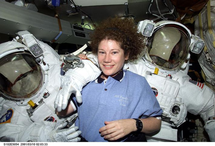 386562 02: Astronaut Susan J. Helms, STS-102 mission specialist, is pictured March 10, 2001 on the mid deck with both Extravehicular Mobility Unit (EMU) space suits designated for extravehicular activity (EVA). Helms is one of two astronauts assigned to space walk duties after the Space Shuttle Discovery and the International Space Station (ISS) link in Earth orbit. The photograph was recorded with a digital still camera. (Photo courtesy of NASA/Newsmakers). GETTY IMAGES.